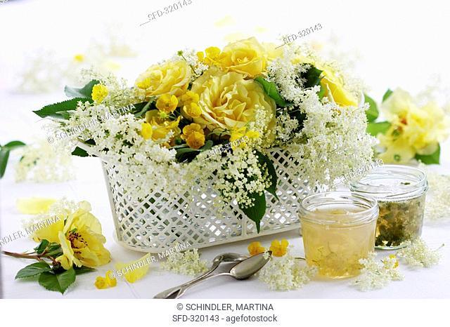 Table arrangement of perfumed roses and elderflowers