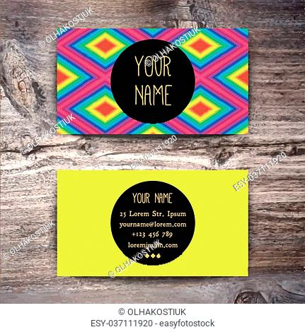 Business card template with creative geometric pattern on wooden background