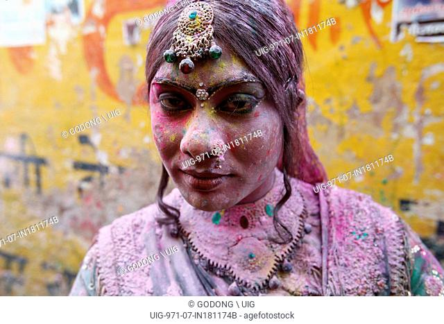 Transvestite celebrating Holi festival