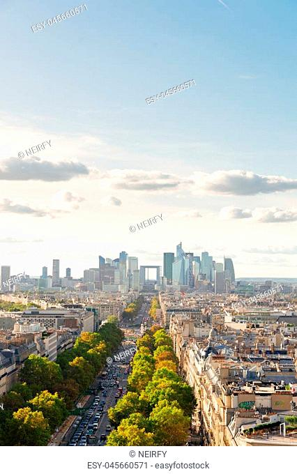 skyline of Paris city towards La Defense district from above with blue sky, France