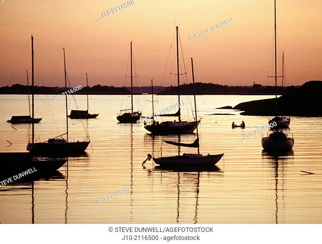 Sunset harbor with rowboat & sailboats, Southport, Fairfield County, Connecticut, USA