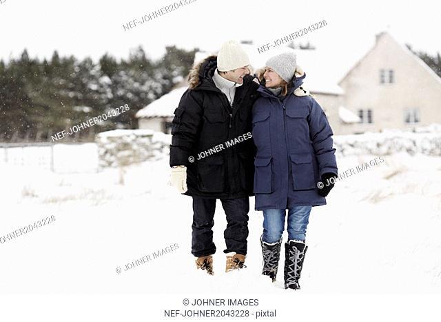 Couple walking at winter