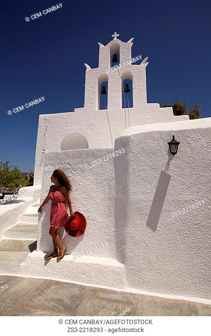 Woman in front of a church, the Byzantine church of Agia Irini near the Ormos harbour, Ios, Cyclades Islands, Greek Islands, Greece, Europe