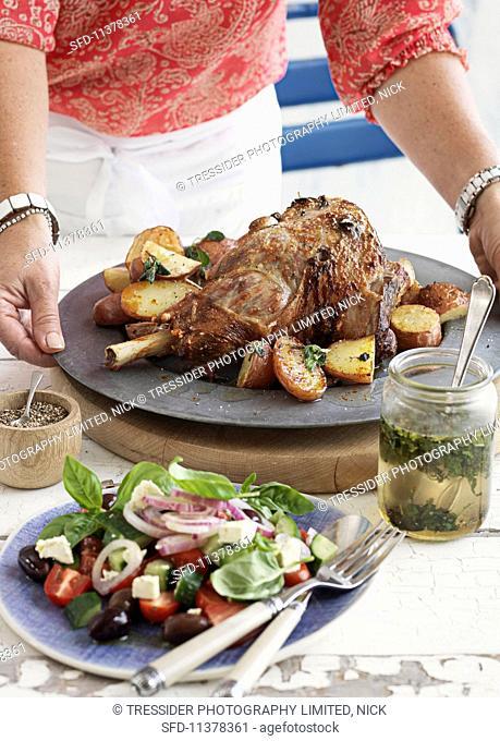 Roast lamb with potatoes and salad