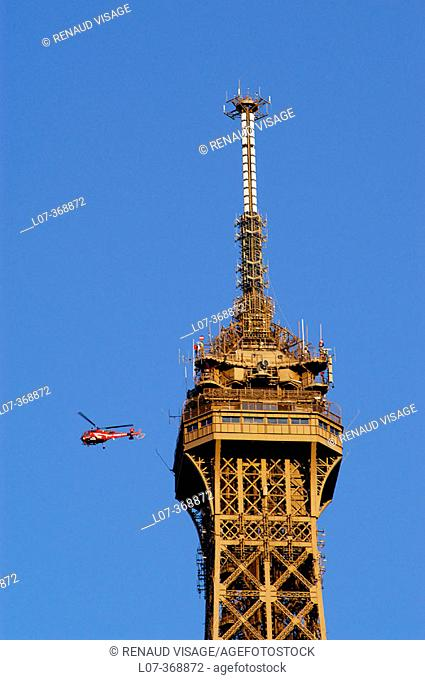 Top of the Eiffel Tower and helicopter. Paris. France