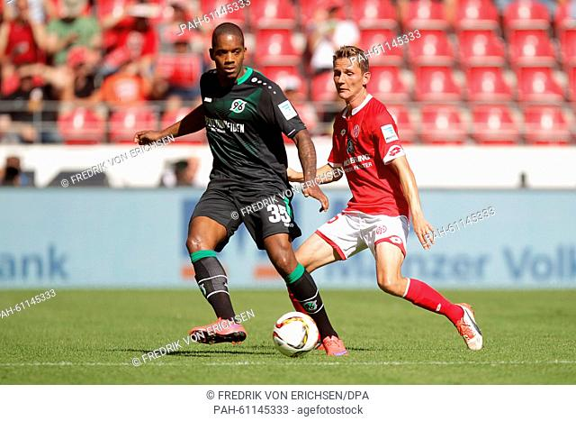 Mainz' Niko Bungert (r) and Hanover's Charlison Benschop (l) vie for the ball during the German Bundesliga soccer match between 1
