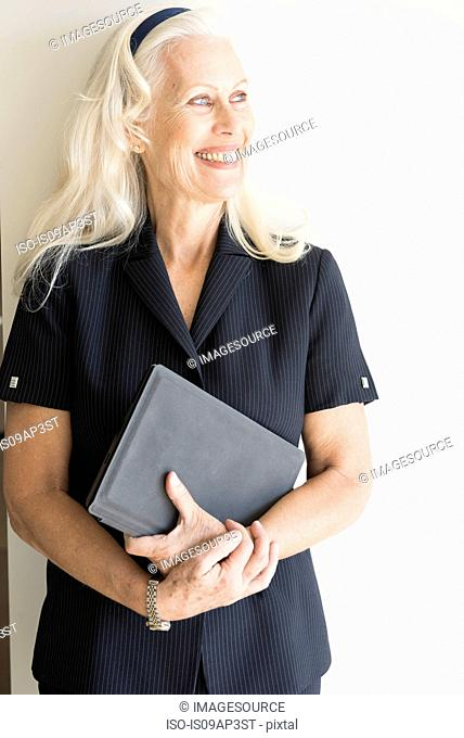 Confident senior businesswoman looking away