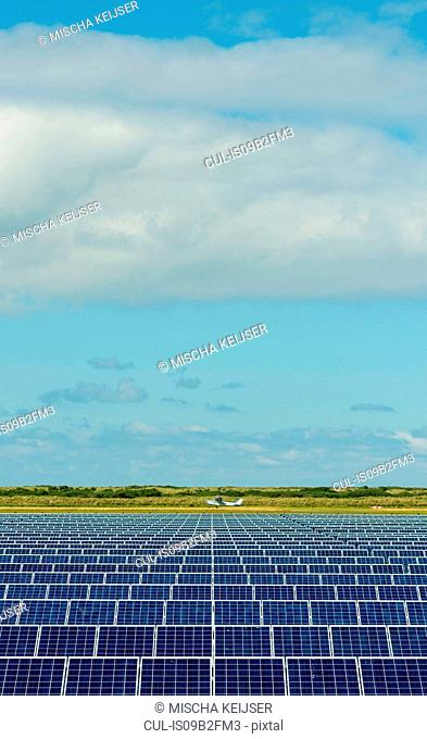 Solar panels and airplane in airfield, Ballum, Friesland, Netherlands