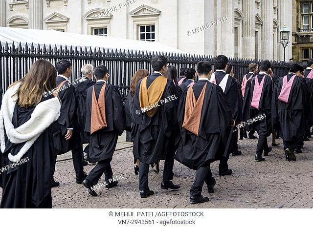 Graduates from the University of Cambridge walking to their graduation ceremony at the Senate House, Cambridge, England, UK. 25 June 2016