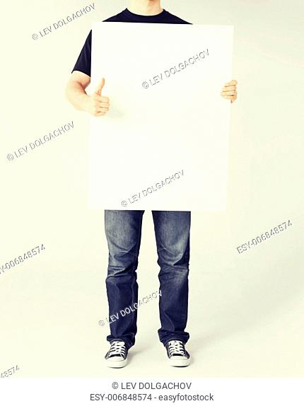 business and advertisement concept - man showing white blank board and thumbs up