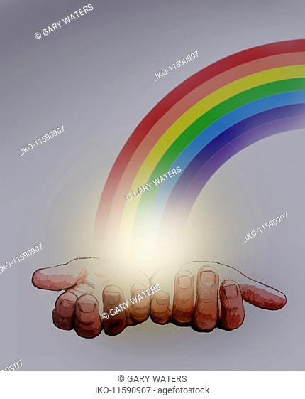 Outstretched hands holding end of the rainbow