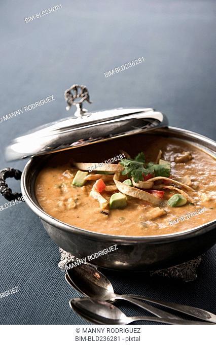 Tortilla soup in silver pot