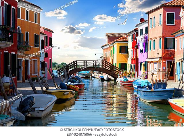 Bridge and colored houses on the street in Burano, Italy