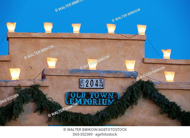 Old Town Emporium sign with candles in the evening, old town Albuquerque. New Mexico, USA