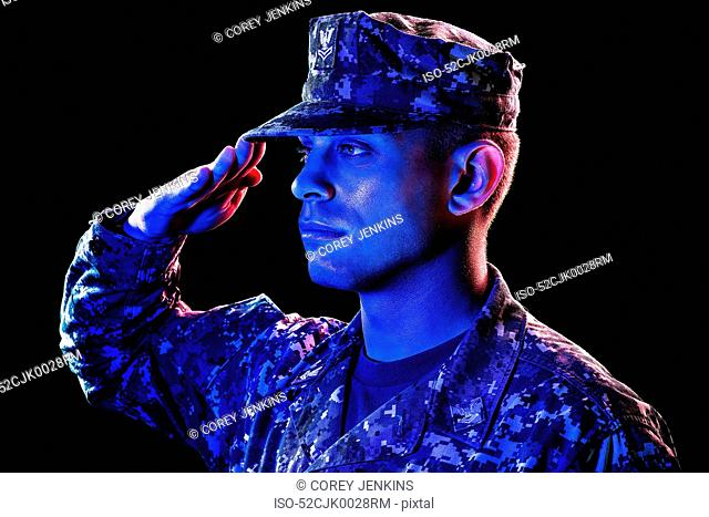 Close up of soldier saluting