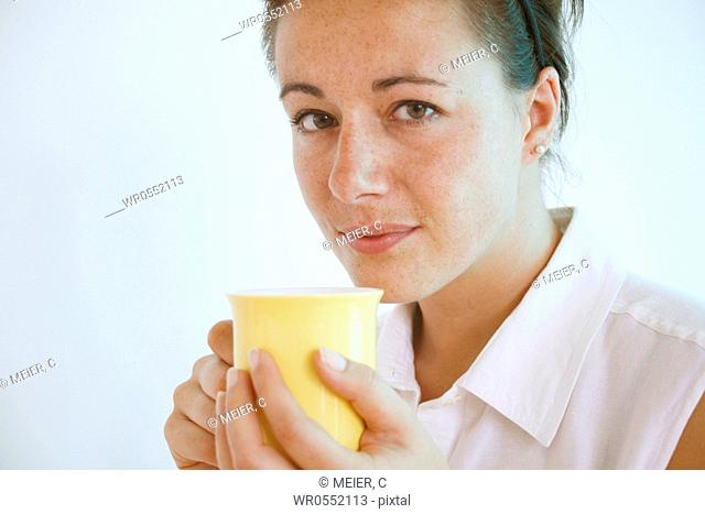 Young woman holds a cup