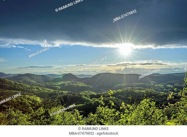 Landscape with sun in spring, Castle Lindelbrunn, Vorderweidenthal, Pfälzerwald, Südliche Weinstraße District, Rhineland-Palatinate, Germany