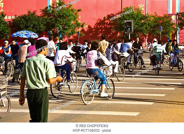 Group of people riding bicycles, HohHot, Inner Mongolia, China