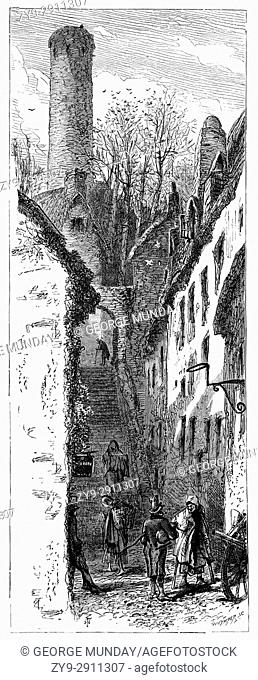 1870: An early-surviving flight of cut-limestone steps built by Robert Wale (Wall), procurator of the adjacent Saint Canice's Cathedral in 1614