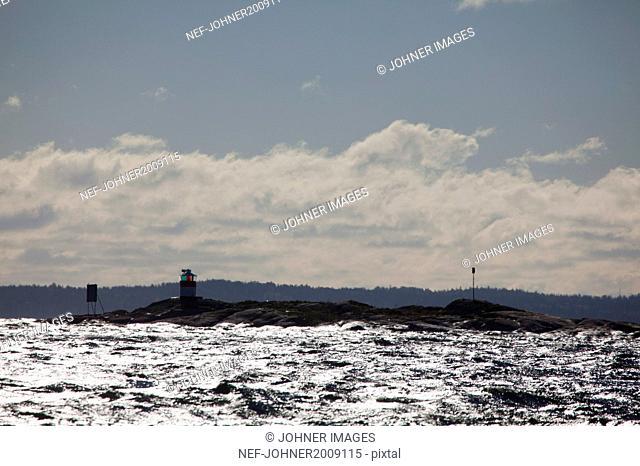 Sea with lighthouse on coast