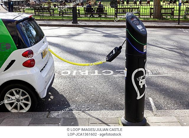 An electric car at a charging point in Berkeley Square in London