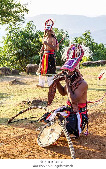 Manggarai men wearing traditional headdress wrapped with cloth and wielding shields and bamboo whips before a caci, a ritual whip fight, Melo village, Flores