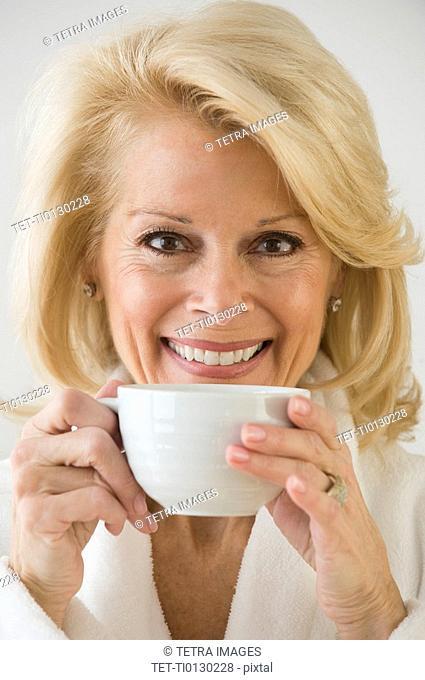 Senior woman drinking coffee