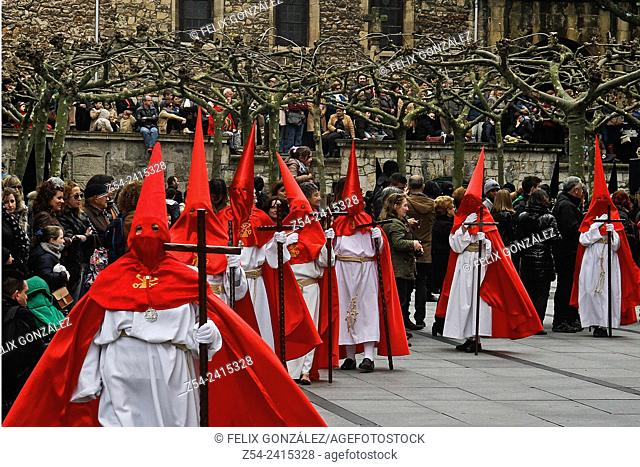 Holly Week Procession,Avilés, Asturias, Spain. Penitents walk in a street during Easter Holy Week