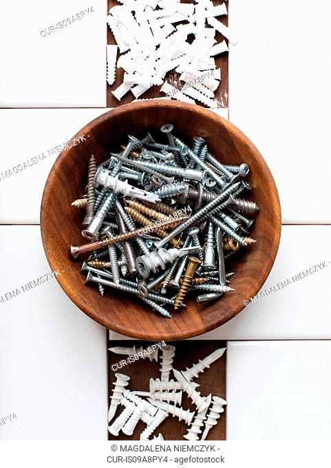 Still life of screws and nails in bowl
