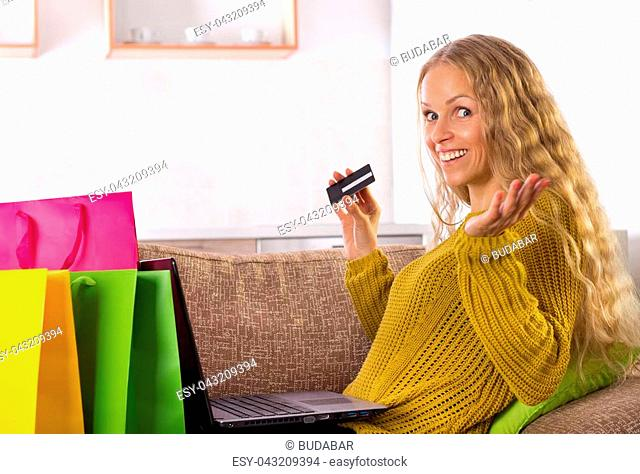 Excited young woman shopping online at home
