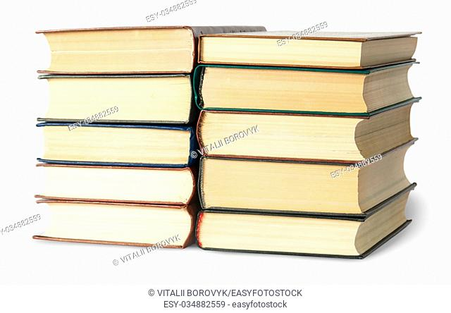 Two stacks of old books rotated isolated on white background