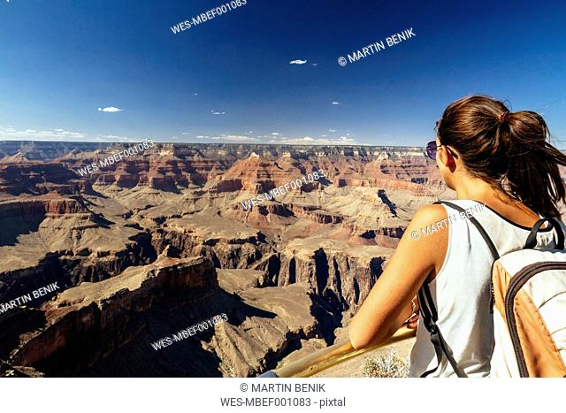 USA, Arizona, young woman enjoying the view at Grand Canyon