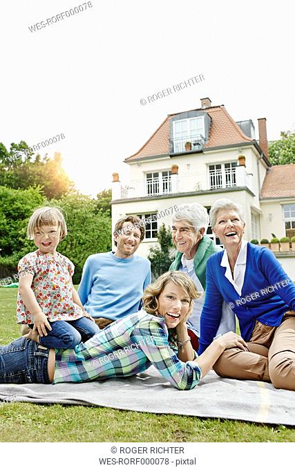 Germany, Hesse, Frankfurt, Three generations family in front of villa