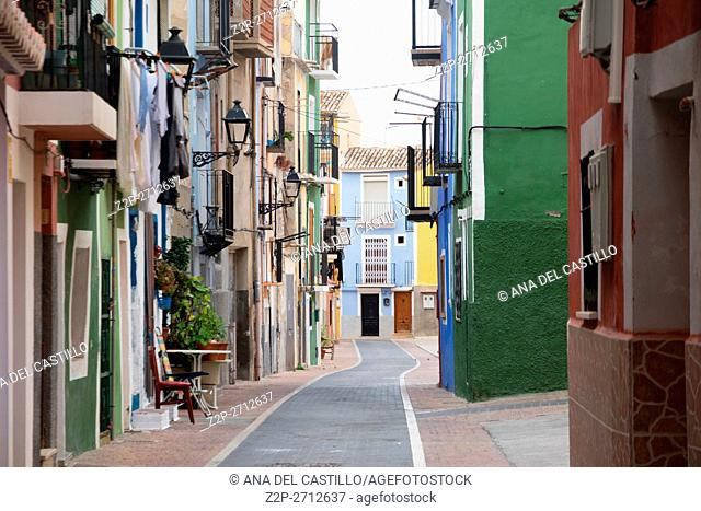 VILLAJOYOSA, SPAIN - JANUARY 14, 2016: A picturesque part of a small fishing village with colorful houses and narrow streets in Alicante