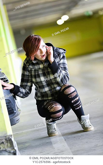 Teen girl is shocked talking on cellphone is wondering