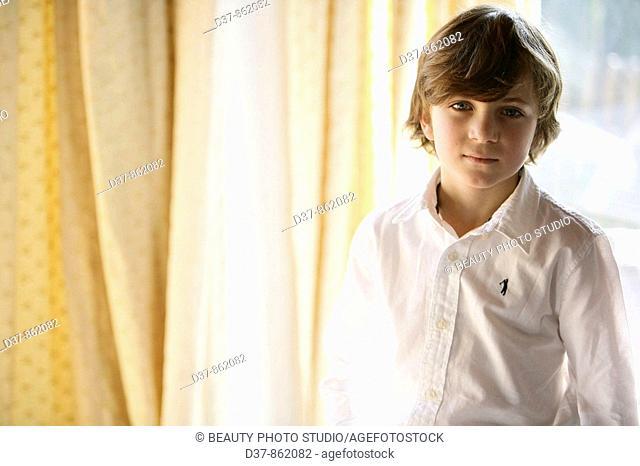Boy standing looking at camera