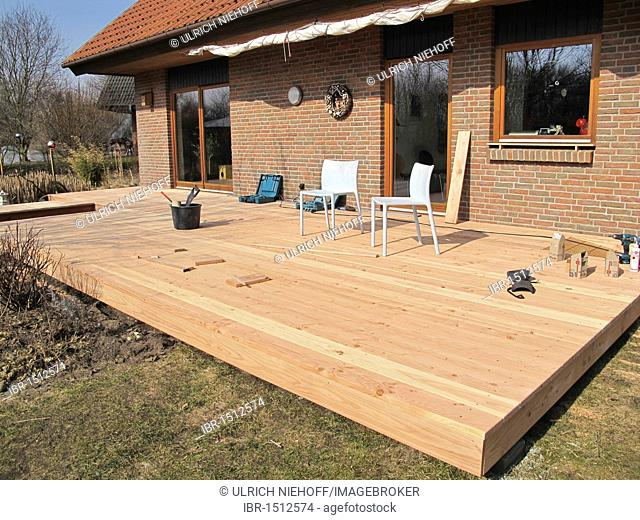 Construction of a wooden deck from Douglas fir planks
