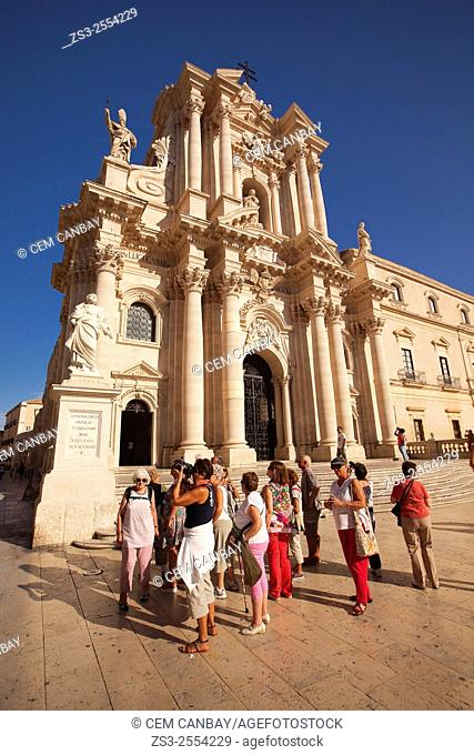 Tourists taking photos in front of the Baroque Duomo cathedral, Syracuse, Sicily, Italy, Europe