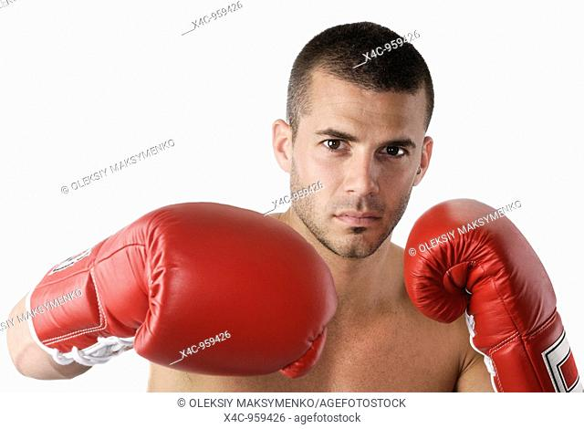 Expressive portrait of a kickboxer in boxing gloves  Isolated on white background