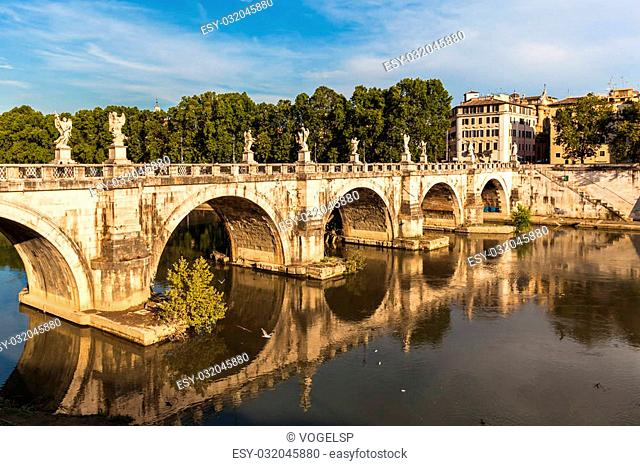 View of the famous bridge Ponte Sant'Angelo in sun light, Rome, Italy