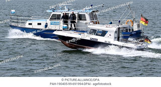 04 April 2019, Bavaria, Herrenchiemsee: Boats of the water police sail on the Chiemsee. Photo: Sven Hoppe/dpa. - Herrenchiemsee/Bavaria/Germany