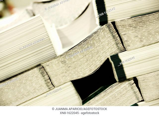 Stack of books waiting to be covered