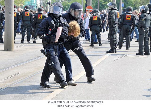 Police officers arresting a demonstrator during a NPD rally in Ulm, Baden-Wuerttemberg, Germany, Europe