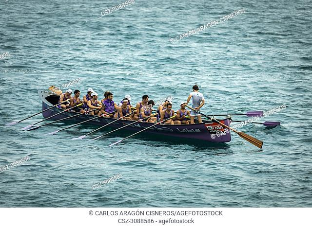 CASTRO URDIALES, SPAIN - JULY 15, 2018: Competition of boats, regata of trainera, San Pedro, Libia boat in action in the VI Bandera CaixaBank competition