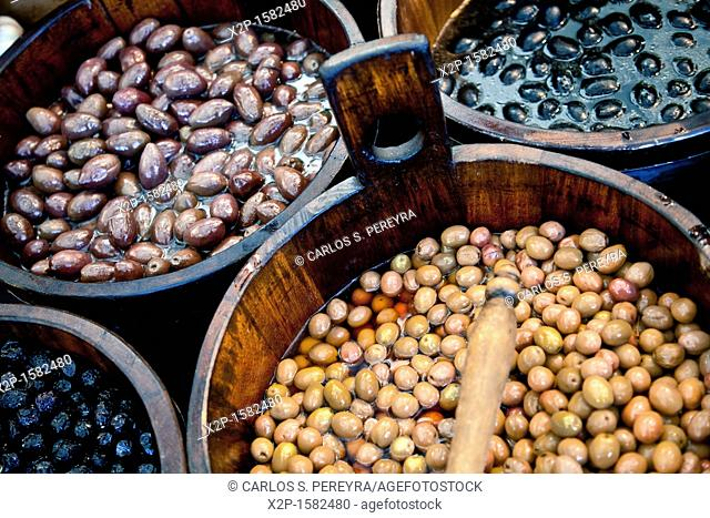 Sales of traditional products -Mediterranan olives- in the market and selected market Viktualienmarkt, Munich, Germany