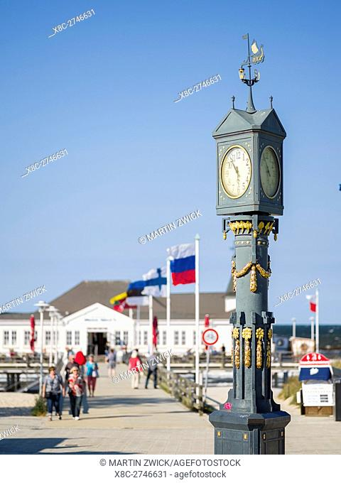 The art nouveau clock at the famous pier in Ahlbeck on the island of Usedom. Europe,Germany, Mecklenburg-Western Pomerania, Usedom, June