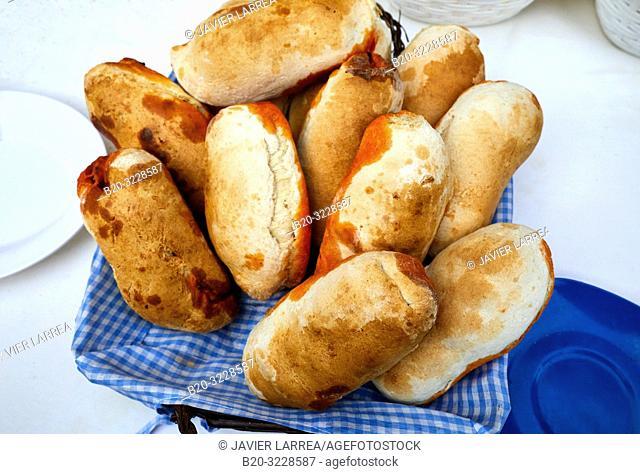 Breads stuffed with chorizo, folklore fair of Santo Tomas, Donostia, San Sebastian, Gipuzkoa, Basque Country, Spain, Europe