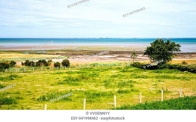 travel to France - green gardens on coast of Anse de Beauport bay in Kerity district of Paimpol town in Cotes-d'Armor department of Brittany in summer sunny day