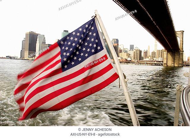 American flag, skyline and Brooklyn bridge, Circle Line, New York City, USA