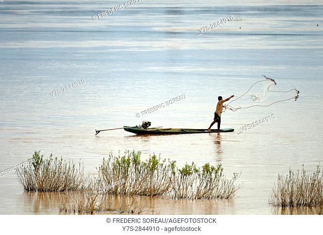 A fisherman fishing with a net,Four Thousand islands, South Laos,Southeast Asia